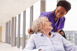 senior-in-wheelchair-with-health-care-aid-doctor-visit